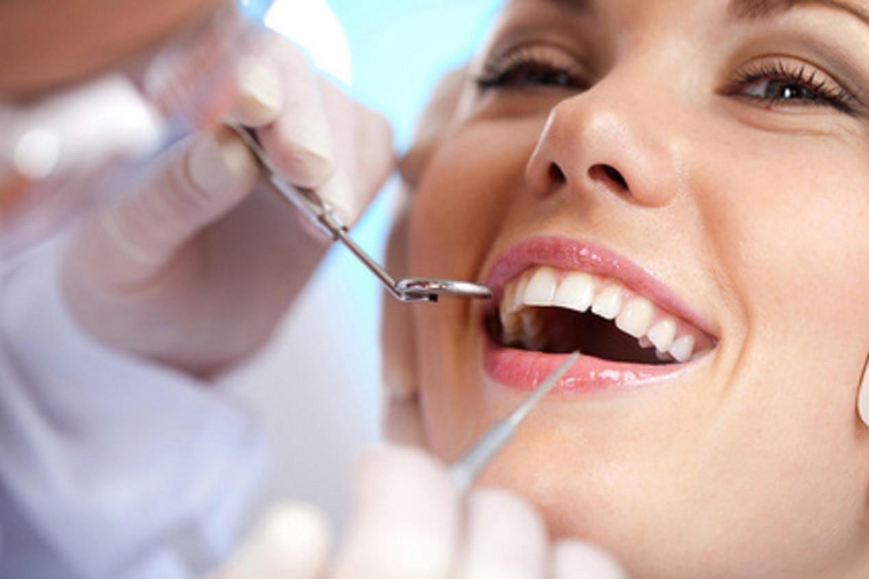 Как отбелить потемневший зуб?