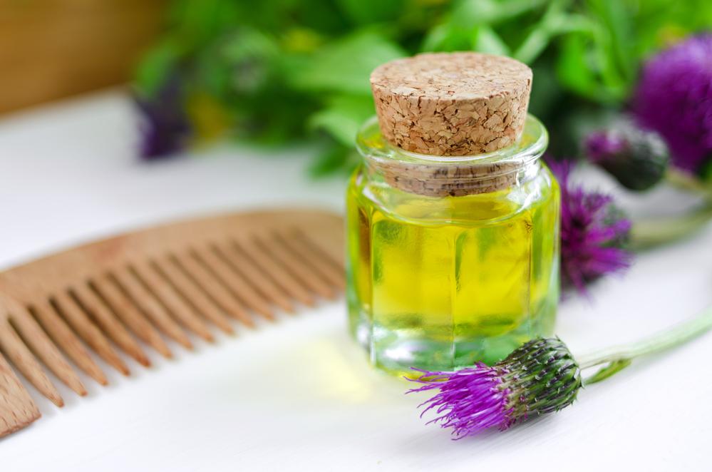 Состав репейного масла и его польза для волос